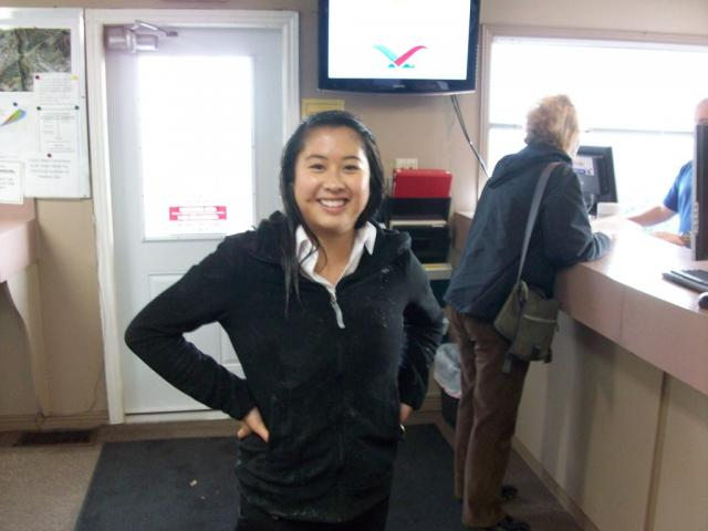 Ashley Ha tries to keep warm inside following her saturation: She does look happy despite the dampness!!