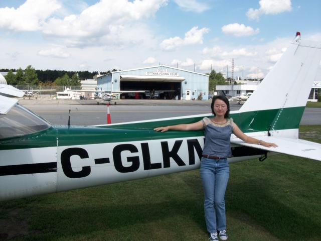 Quichen stands proudly in front of Cessna 150 GLKN: An important landmark in a pilot's life... first solo...