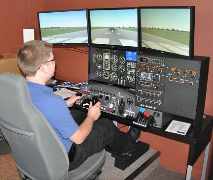 Chris Busch at the controls of OFC's simulator.