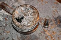 Piston Damage: The effects of having a loose valve head in the cylinder of an operating engine.