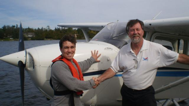 Stephen Keays being congratulated by CFI John Porter after his Float Plane rating
